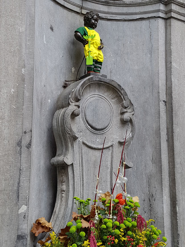 Brussel's famous citizen Manneken Pis in his autumn outfit.