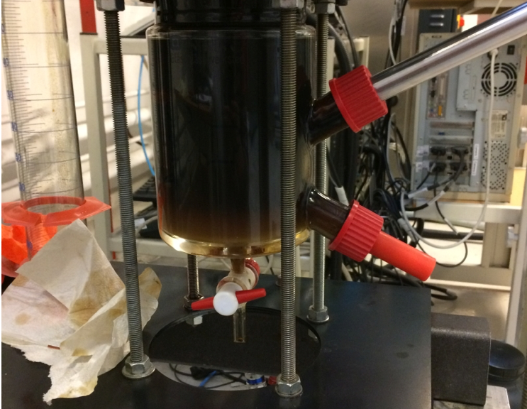 An experimental tank cell facility for measuring emulsion dynamics in a crude oil-water flowing system with an inserted probe camera.