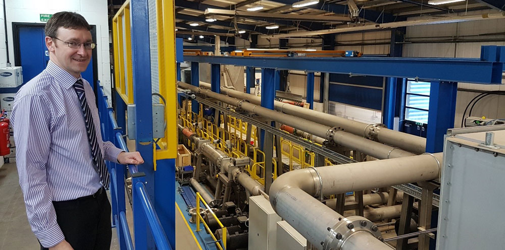 Technical director Edward Jukes and the mass flow meter calibration facility.