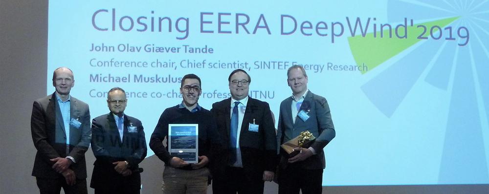 EERA DeepWind 2019 Erick F. Alves (NTNU, middle) receiving the Best Poster Award for Best Presentation at EERA DeepWind from John Olav Giæver Tande (Conference Chair, SINTEF, left), Prof Olimpo Anaya-Lara (Strathclyde university), Prof Trond Kvamsdal (NTNU) and Prof Michael Muskulus (NTNU)
