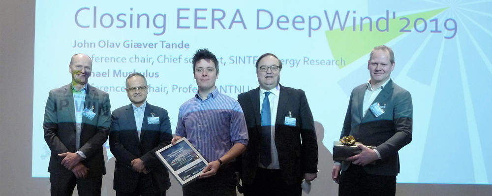EERA DeepWind 2019 - Cian Desmond (MaREI Centre, ERI, University College Cork, Ireland), receiving the Best Poster Award for Best Content at EERADeepWind from John Olav Giæver Tande (conference chair, SINTEF, left), Prof Olimpo Anaya-Lara (Strathclyde University), Prof Trond Kvamsdal (NTNU) and Prof Michael Muskulus (NTNU)