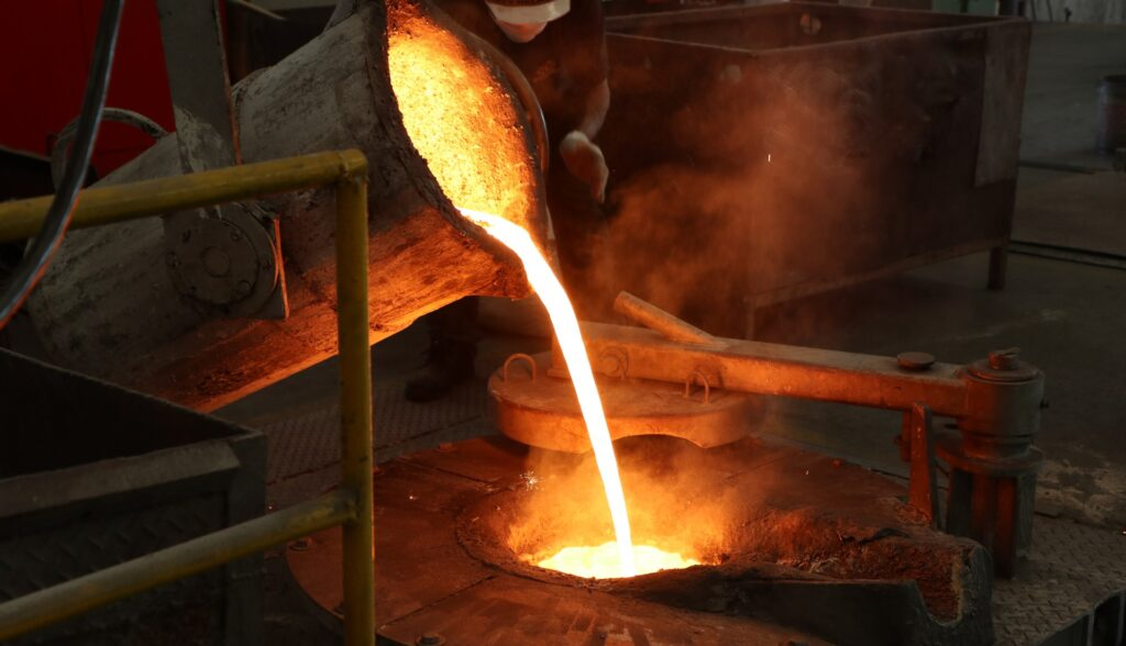 Molten iron poured into furnace during casting process