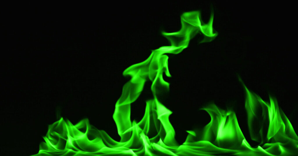 Green flames on black background
