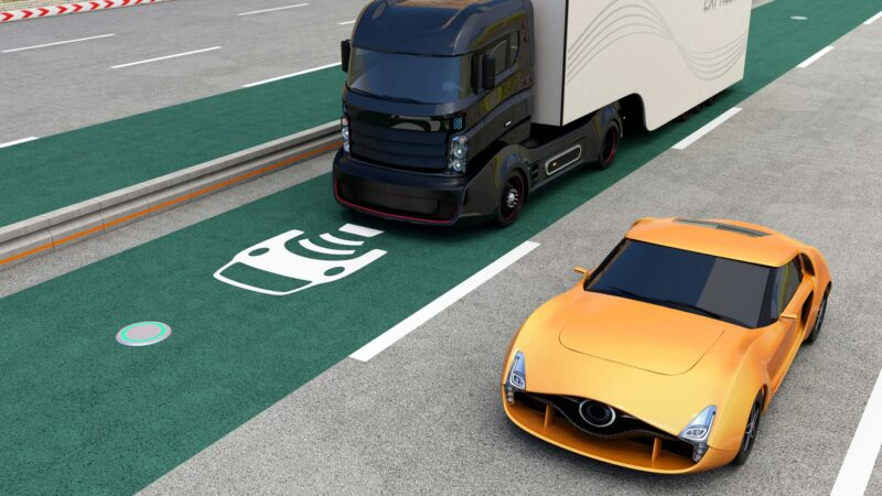 Image showing wireless dynamic charging of electric vehicles on a road