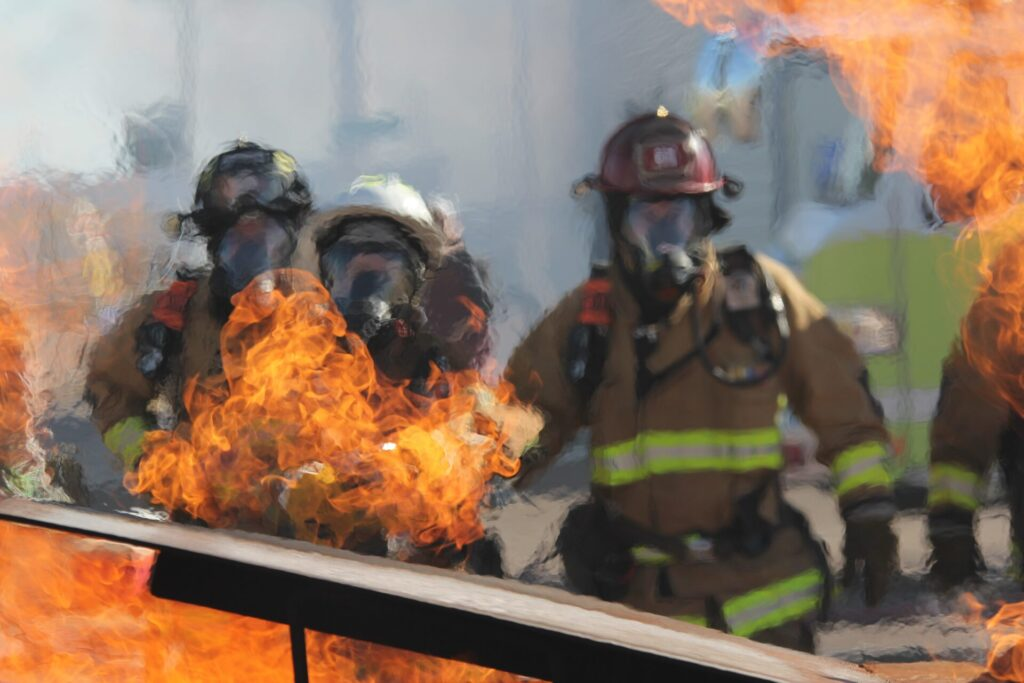 Three fire fighters and a fire